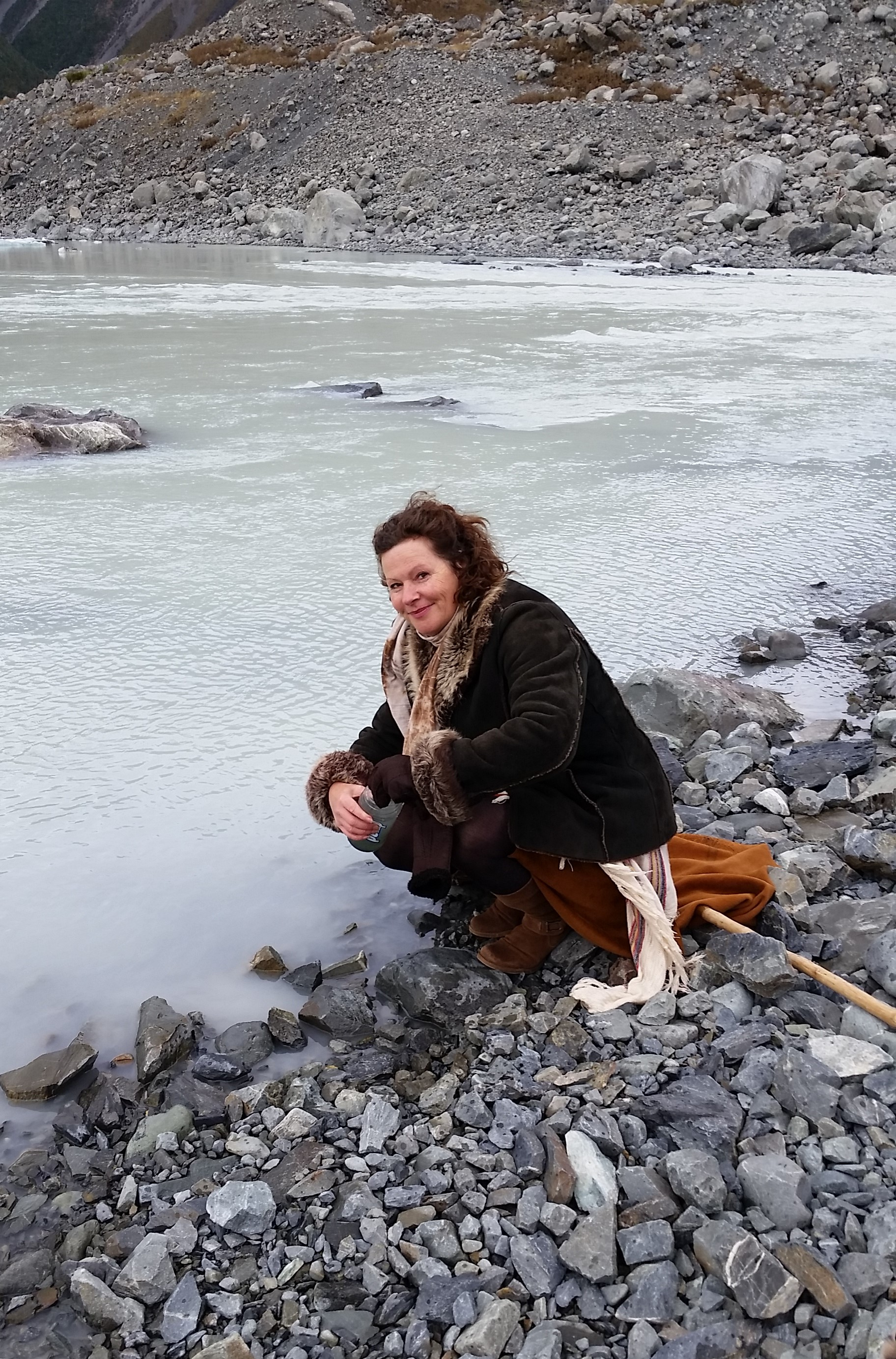 Annwyn gathering glacial water at Purification ceremony